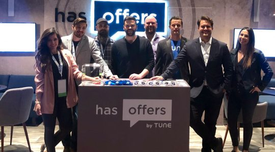 The HasOffers by TUNE team poses in front of their booth at Affiliate Summit West 2019