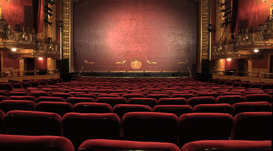 Image of a theater stage and seats
